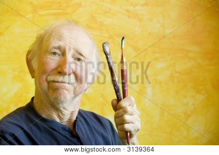 Artist With A Beret And Brushes With Copy Space