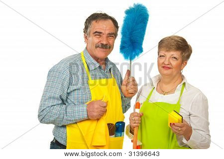Happy Team Of Mature Cleaning People