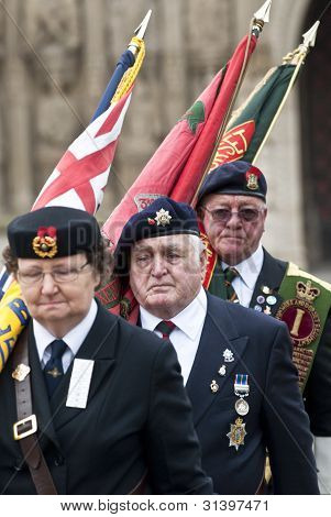 Flag Barers From The Royal British Legion March With Their Flags From Exeter Cathedral