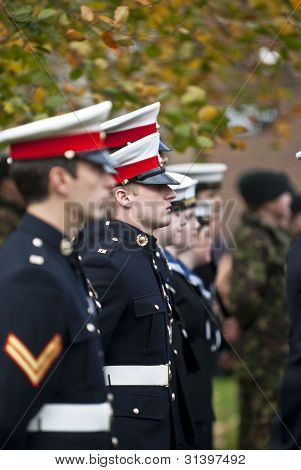Soldiers Stand To Atention During The Rememberance Day Service