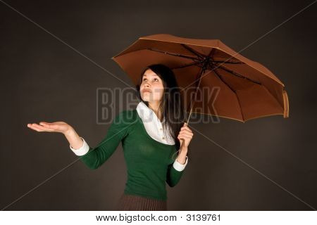 Girl With Umbrella Checking For Rain