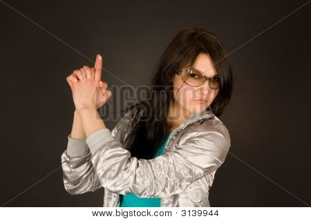 Fashion Girl Pointing Her Hand Like A Gun