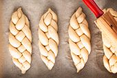 Homemade Food Concept Process Braiding Bread Braid Challah Dough On White Background With Copy Space poster