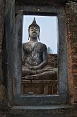 View Through The Frame On Seated Buddha Statue In Famous Sukhothai Historical Park, A Unesco World H poster
