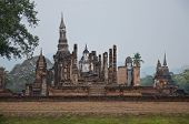 Ruins Of Unique Temples In Famous Sukhothai Historical Park, A Unesco World Heritage Site, Foggy Spr poster