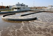 stock photo of sedimentation  - Water treatment plant on sunny day recycling polluted water - JPG