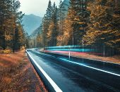 Blurred Car On The Road In Autumn Forest In Rain. Perfect Asphalt Mountain Road In Overcast Rainy Da poster