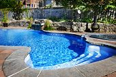 foto of hot-tub  - Residential inground swimming pool in backyard with waterfall and hot tub - JPG