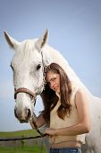 foto of white horse  - portraite of attractive girl with horse - JPG