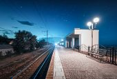 Beautiful Railway Station At Night In Summer. Rural Railroad At Dusk. Industrial Landscape With Rail poster