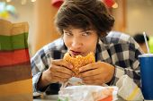 Young Teenager, Unhealthy Eating, Food Addict Concept, Addiction poster