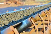 image of porphyry  - ore conveyor shoot on sunset inside of plant - JPG