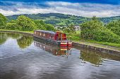 Narrowboat Moored On A British Canal In Rural Setting poster