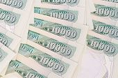 picture of ten thousand dollars  - close up of ten thousand iraqi dinar notes - JPG
