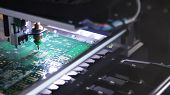 Electronic Circuit Board Close Up. Media. Process Of Creating An Electronic Chip. Automatic Operatio poster