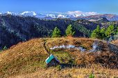 Beautiful Scenic Autumn Landscape Of Snowy West Caucasus Mountain Peaks Under Blue Sky On Sunny Day  poster
