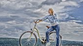 Health Benefits Of Cycling. Woman Rides Bicycle Sky Background. Increase Muscle Strength And Flexibi poster