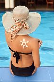 Woman Apply Sun Cream Protection On Tanned Shoulder. Beauty Skincare Sun Aging Protection Body Care  poster