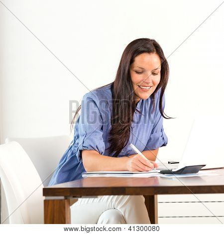 Smiling woman researching library university exam writing essay