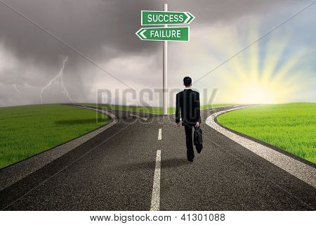Businessman Choosing Path To Success