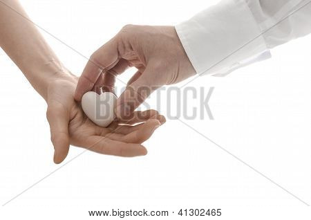 Male Hand Giving A Heart To A Woman