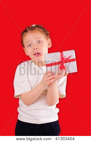 Cute Little Girl With A Gift For Valentine's Day