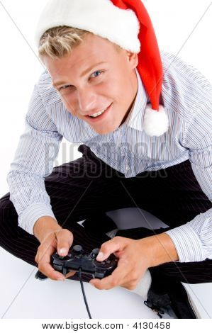 Young Man With Christmas Hat And Remote