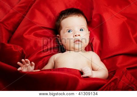 Cute baby porrait on red background