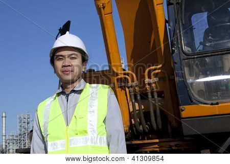 Portrait Construction Worker Standing Front Of Heavy Equipment