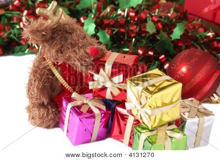 Stack Of Gift Boxes, Tinsel And Moose