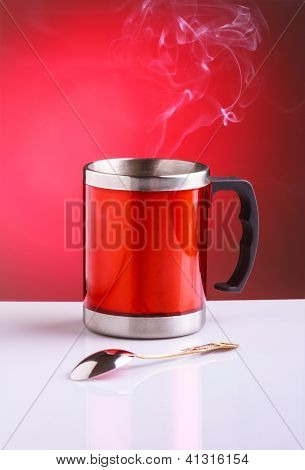 Red Travel Mug With Hot Tea Spoon