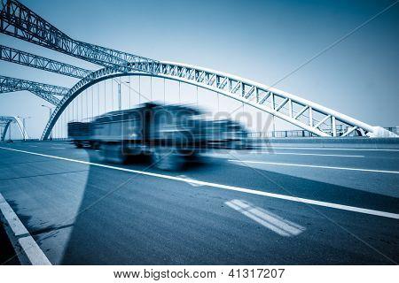 rushing truck go through the bridge