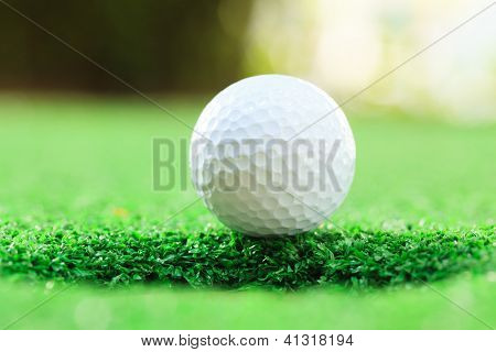 golf ball on lip of cup (Selective focus at golf ball)