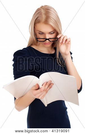 Young woman reading womens magazine
