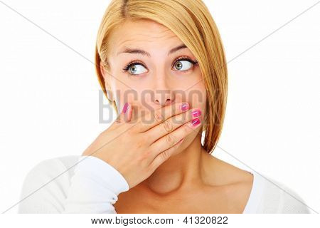 A picture of a young scared woman covering her lips with hands over white background