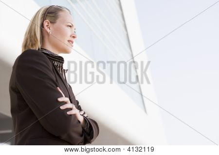 Businesswoman Standing Outdoors By Building