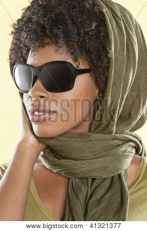 African American woman wearing sunglasses with stole over her head