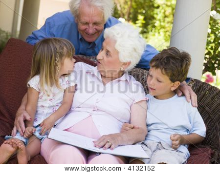 Grandparents Reading To Grandchildren.