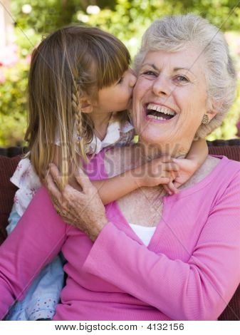 Grandmother Getting A Kiss From Granddaughter.