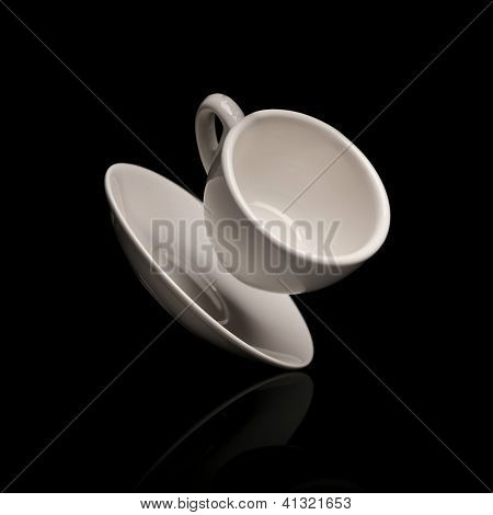 falling coffee cup with saucer