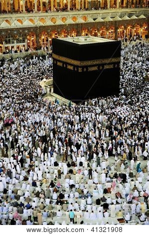 MECCA - JULY 21 : Pilgrims inside the Kaaba on July 21, 2012 in Mecca, Saudi Arabia.  Kaaba in Mecca is the holiest and most visited mosque for all Muslims.