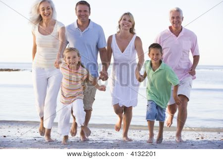 Extended Families Walking On Beach