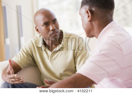Two Men In Living Room Talking