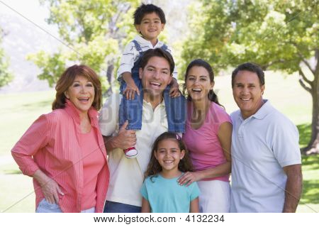 Extended Families Standing Outdoors Smiling