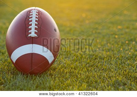 American Football on the Field backlit at Sunset
