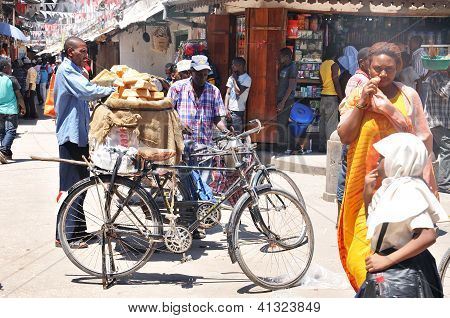 An unidentified street seller sells fresh bread in Zanzibar