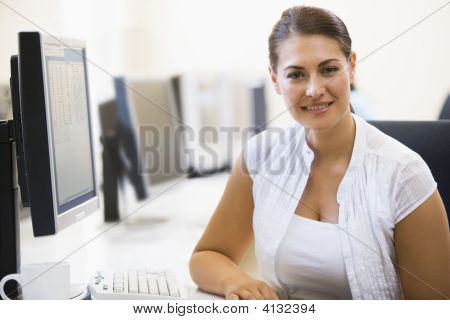 Woman Sitting In Computer Room Smiling