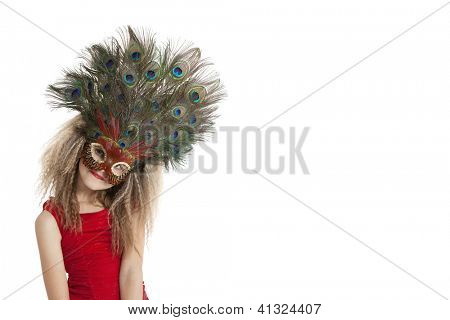 Portrait of a girl in peacock feather mask over white background
