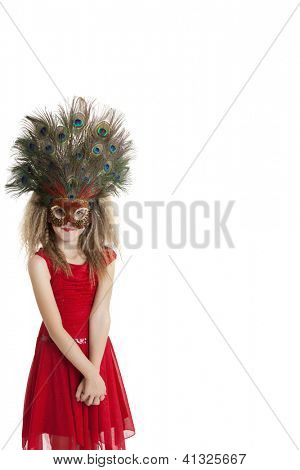 Girl in red outfit wearing peacock mask over white background