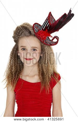 Portrait of happy girl in red outfit and hat over white background